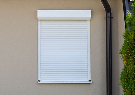 Window with white colour roller shutter